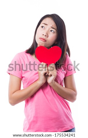 Young woman holding heart on white background - stock photo