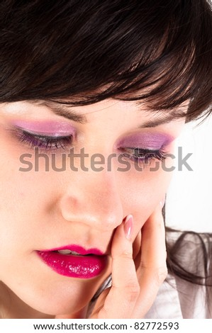 Young woman holding her face - stock photo
