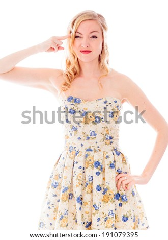 Young Woman holding her finger against her head - stock photo