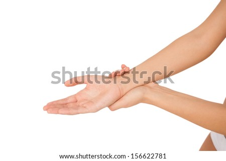 Young woman holding her injured wrist on white background