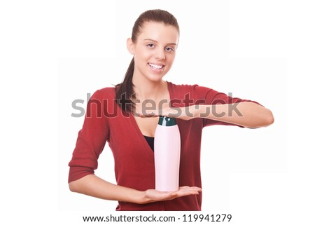 young woman holding in hand blank bottle shampoo - stock photo
