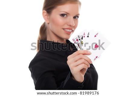 young woman holding in hand poker card with combination of Full House. in focus hand and poker card. - stock photo