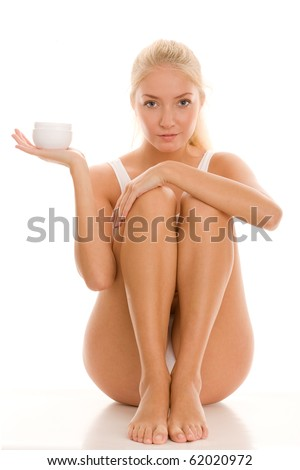 Young woman holding jar of body lotion - stock photo