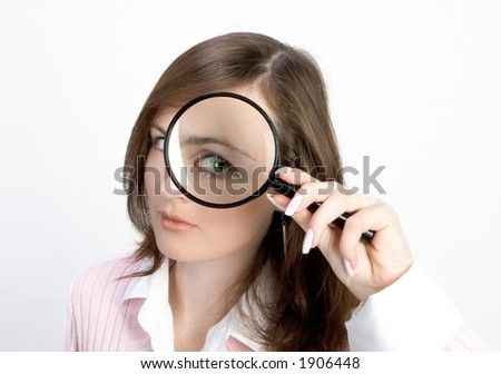 Young Woman holding Magnifying Glass - stock photo