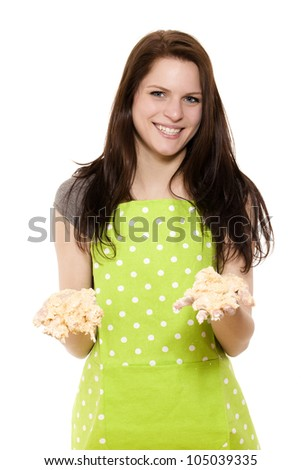 young woman holding messy dough with her handy on white background - stock photo