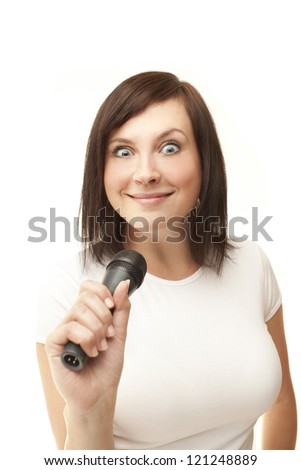 Young woman holding microphone and crazy smiling