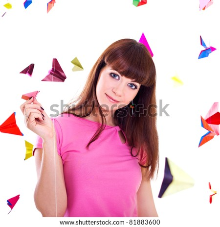 Young woman holding paper airplane - stock photo