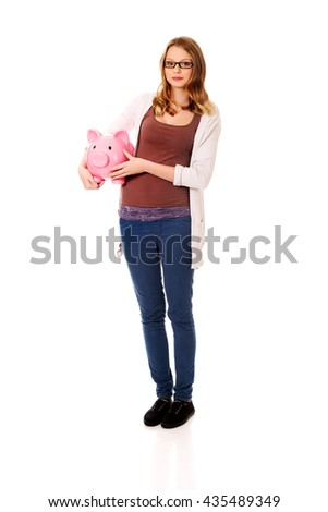 Young woman holding piggybank - stock photo