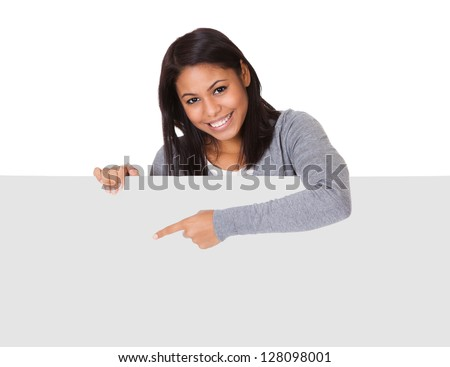 Young Woman Holding Placard. Isolated On White - stock photo