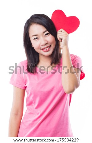 Young woman holding read paper heart on white background - stock photo