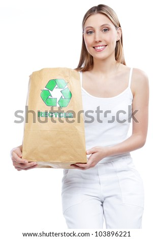 Young woman holding recycle paper bag. - stock photo