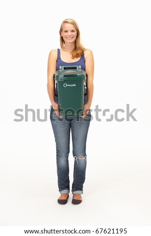 Young woman holding recycling container - stock photo