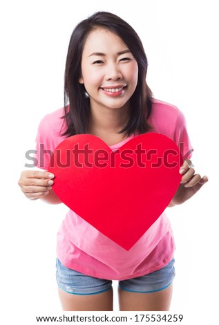 Young woman holding red heart on white background