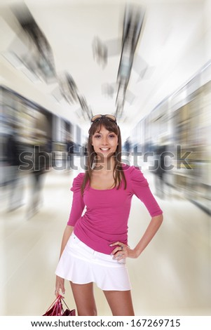 young woman holding shopping at the mall