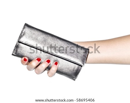 Young woman holding silver, leather wallet on white background - stock photo