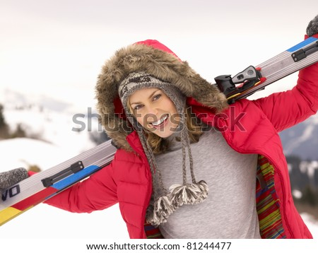 Young Woman holding Skis In Alpine Landscape - stock photo