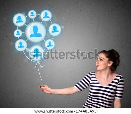 Young woman holding social network balloon