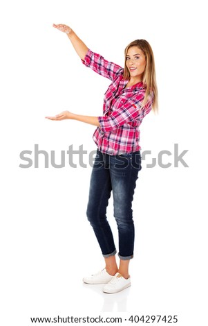 Young woman holding something between her hands - stock photo