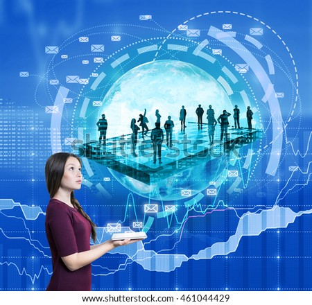 Young woman holding tablet. Image of people silhouettes and planet on background combined with charts and graphs. Concept of work online and business planning. Elements of this image furnished by NASA