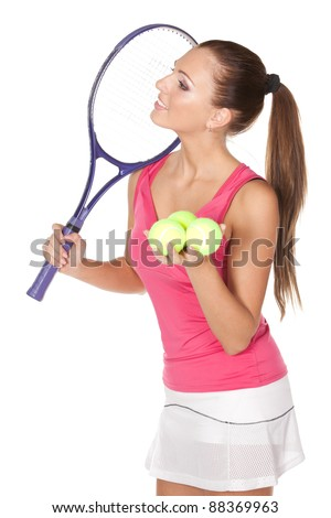 Young woman holding tennis racket and ball looking sideways isolated on white background