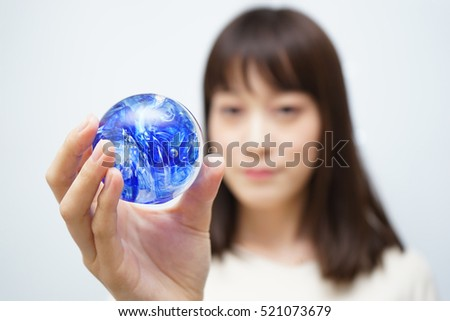 Young woman holding the earth