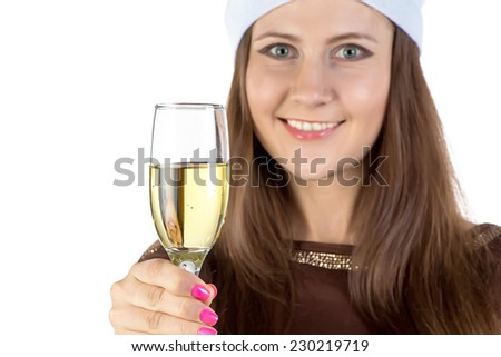 Young woman holding the glass of champagne on white background - stock photo