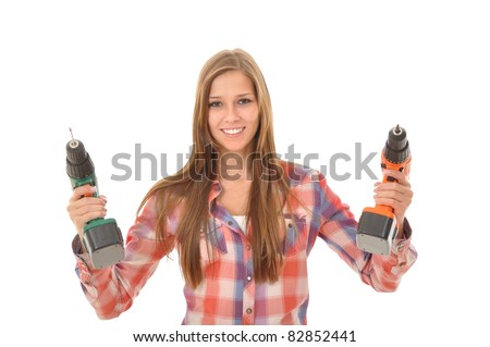 Young woman holding two drills in the air - stock photo