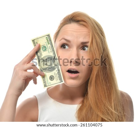 Young woman holding up cash money of one hundred dollars in hand worrried nervous isolated on a white background - stock photo