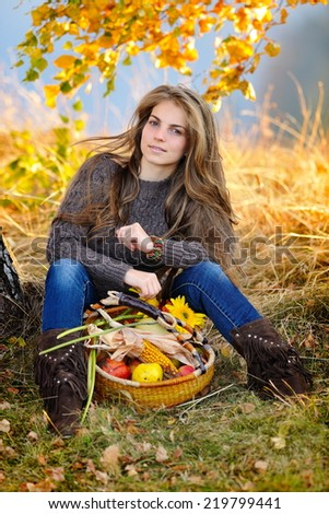 young woman holding vegetables basket outdoor - stock photo