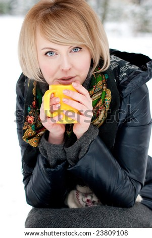 young woman holding yellow cup