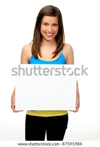 young woman holds a blank board providing copyspace for any advertising. friendly, approachable and smiling - stock photo