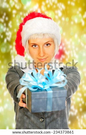 Young woman holds a giftbox in her hands - stock photo