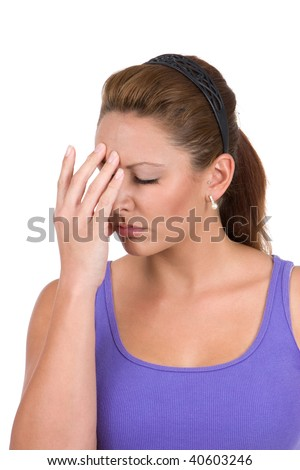 Young woman holds her hand to head trying to cope with a stressful situation. - stock photo