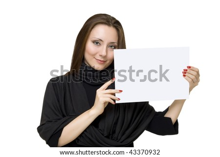 young woman holds the white sheet of paper - stock photo