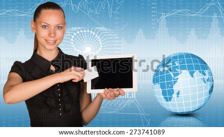 Young woman holging tablet and looking at camera. Model of earth on light background with graphical charts. Elements of this image furnished by NASA