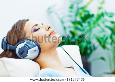 Young woman home portrait. Sleeping girl with headphones. Music. - stock photo