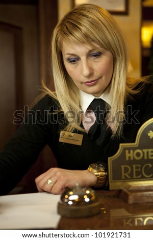 Young Woman Hotel Receptionist At The Front Desk - stock photo
