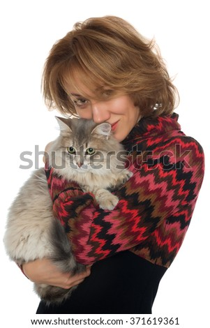 Young woman hugging a cat - stock photo