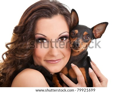 young woman hugging her miniature pincher puppy, close up, isolated on white - stock photo