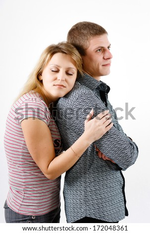 young woman hugging man from the back - stock photo