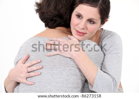 young woman hugging mother - stock photo