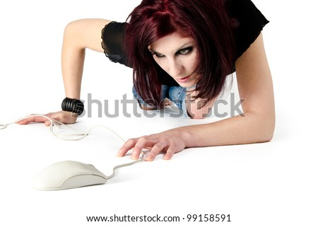 Young woman hunting a computer mouse like a cat - stock photo