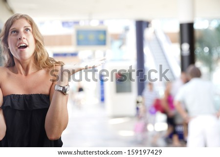 young woman imploring gesture in a shopping center - stock photo