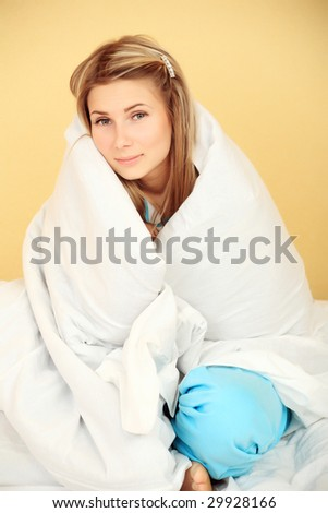 Young woman in a bed with flu.