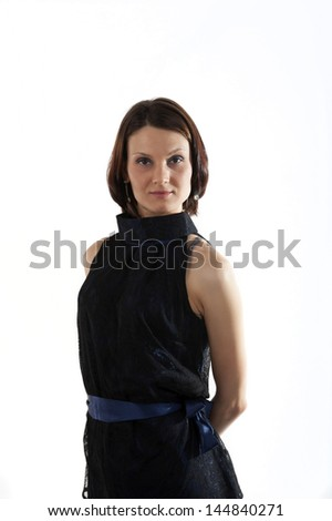 Young woman in a blue dress with a white background