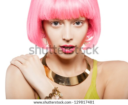 young woman in a bright pink wig, indoor - stock photo