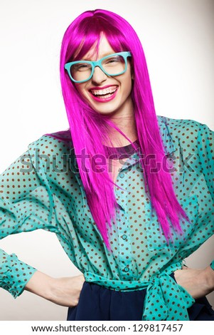 young woman in a bright purple wig, indoor