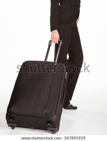 Young woman in a business suit with trunk, white background - stock photo