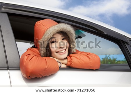 young woman in a car with winter wear