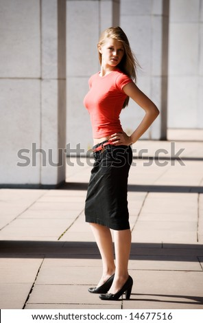 Young woman in a city. On pillars background. - stock photo